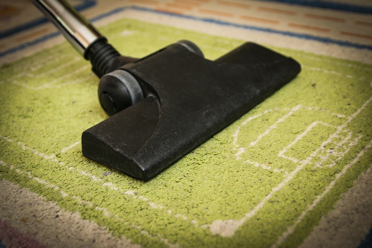 Hoovering a strip of carpet