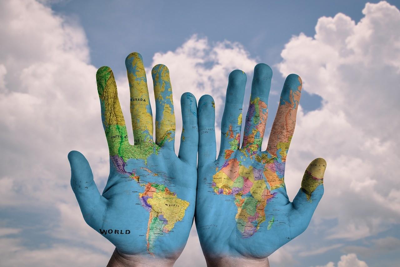 Blue hand, world map, save the world
